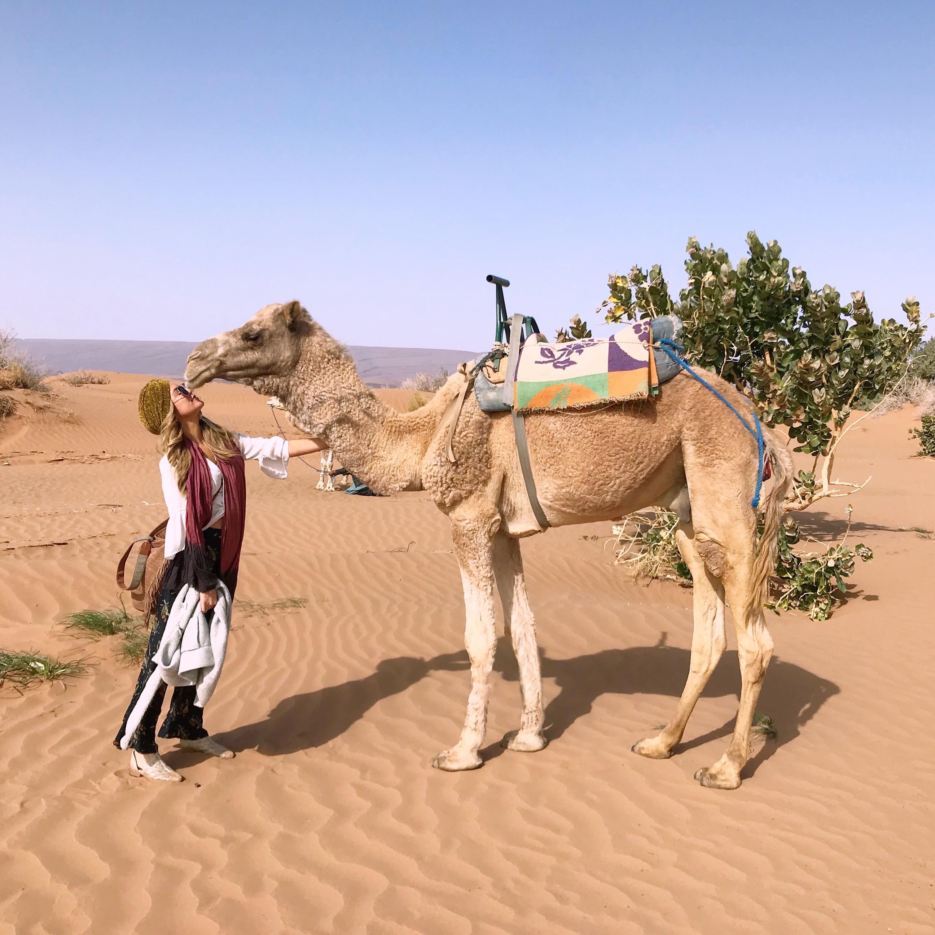 Chelsea Gilson kissing camel